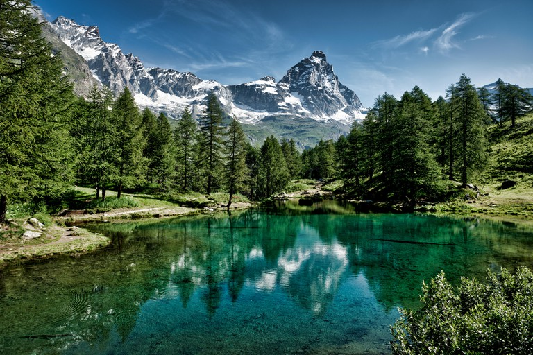The blue lake and the Matterhorn in a scenic summer landscape with sunny lights seen from Breuil-Cervinia, Aosta Valley - Italy