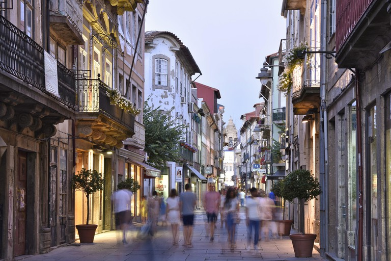 Rua do Souto - traditional shopping street, walkway and old town buildings illuminated at dusk in Braga Portugal Europe.