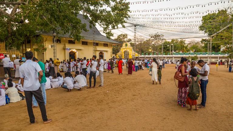 Buddhist pilgrims during a celebration at the Buddhist part of the Ruhunu Maha Kataragama Devalaya temple