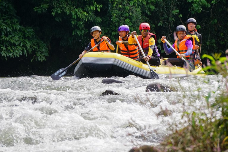 Kiulu Sabah Malaysia - Nov 11, 2018 : Group of adventurer doing white water rafting activity at Kiulu river Sabah Malaysian Borneo on Nov 11, 2018.The