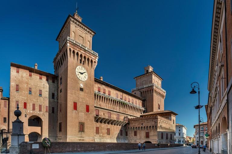 Eastern side of Castello Estense (Castello di San Michele), medieval castle at Corso Martiri della Liberta, street in Ferrara, Emilia-Romagna, Italy