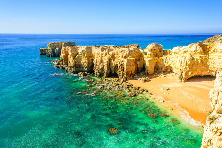 beautiful sea view with secret sandy beach among rocks and cliffs near Albufeira in Algarve, Portugal