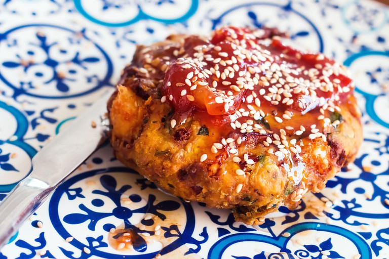 Traditional Greek fried cheese (saganaki) with tomato sauce, selective focus