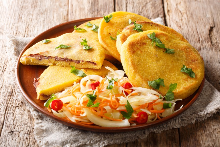 Tasty vegetarian pupusas recipe served with curtido closeup on a plate on the table. horizontal