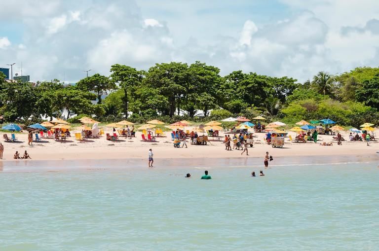 Joao Pessoa - PB, Brazil - February 24, 2019: Local people and tourists at Tambau beach (praia de tambau) on a sunday enjoying the beach on a beautifu