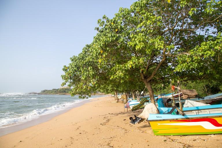 Tropical beach with fishing boats, Sri Lanka