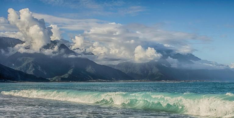 Beautiful beach with the mountain of Taroko National Park in the bacground. Chishintan Beach in Hualien,  Qixingtan Beach,Taiwan