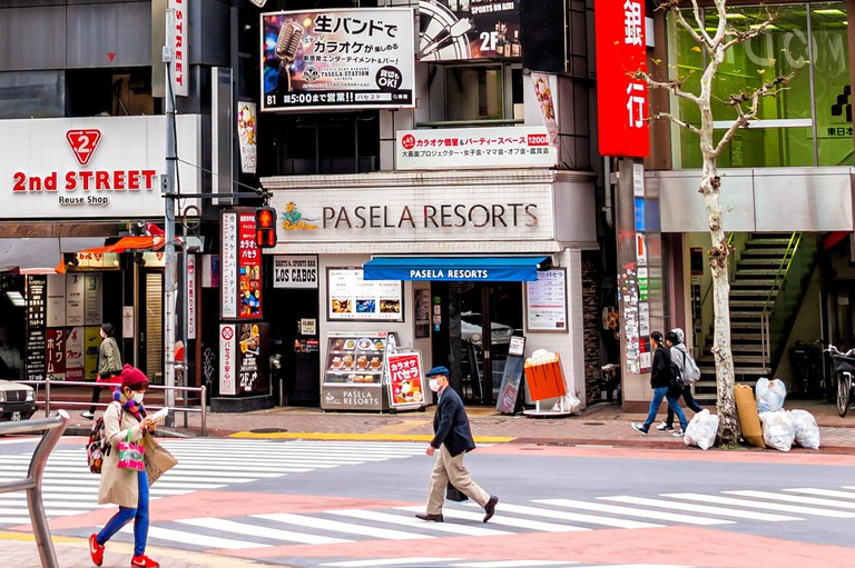 Tokyo, Japan - March 28, 2019: Shibuya district street in downtown city with sign and colorful modern architecture with shopping stores shops