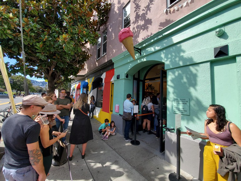 People wait in long lines outside the popular Bi-Rite Creamery ice cream shop in the Mission District neighborhood of San Francisco, California, October 6, 2019. ()