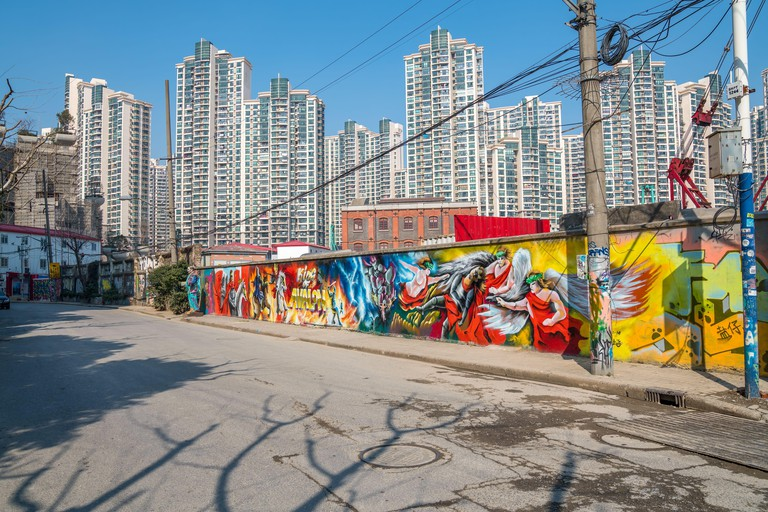 SHANGHAI, CHINA - FEBRUARY 19, 2018: Mural paintings in Moganshan Road, known as M50, is a contemporary art district with many galleries located in an. Image shot 2018. Exact date unknown.