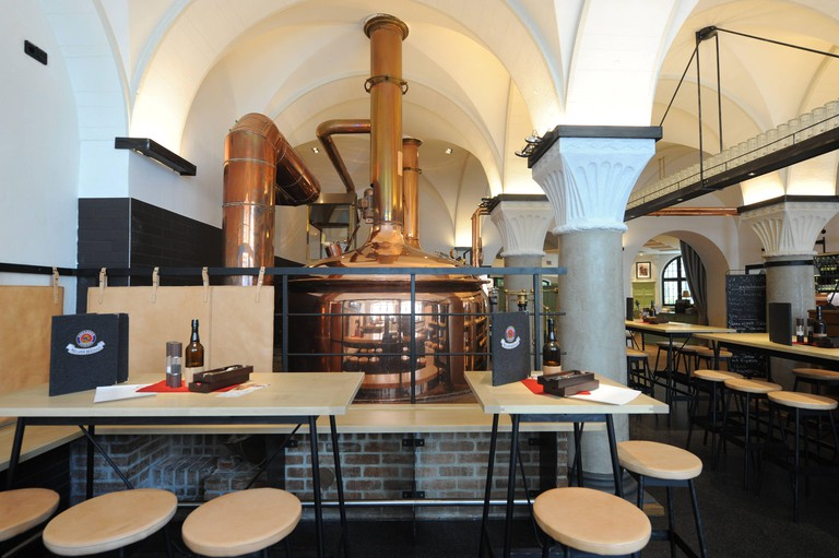 View of the restaurant with brewing kettle in the newly renovated Paulaner Brauhaus on Kapuzinerplatz. [automated translation]