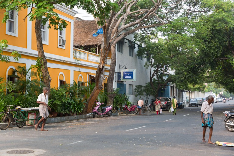 Pondicherry, India - November 7, 2019: Street with colorful houses at Pondicherry in India