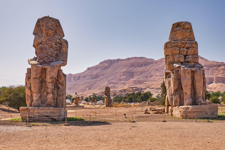 Colossi of Memnon, massive stone statues of the Pharaoh Amenhotep III in the Valley of Kings, Luxor, Egypt.. Image shot 2019. Exact date unknown.