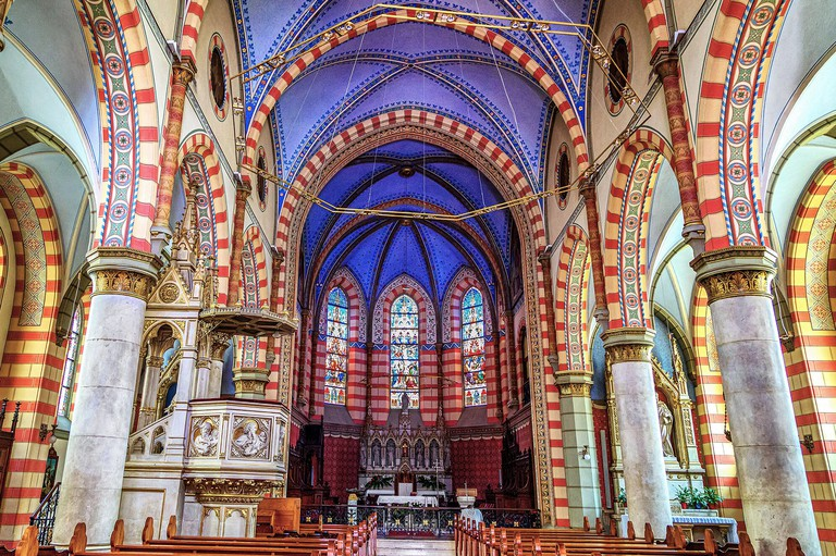 The Jesus' Sacred Heart Cathedral interior in Sarajevo,Bosnia and Herzegovina.The Nave and the Altar, at the central aisle.