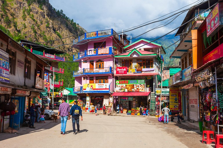 KASOL, INDIA - OCTOBER 02, 2019: Local houses at the main street in Kasol village in Himachal Pradesh state in India