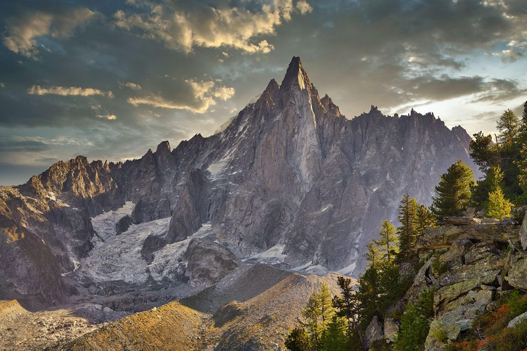 Autumn in the high mountains of the French Alps. Aiguille du Dru in the Mont Blanc massif near Chamonix, Haute-Savoie, France.