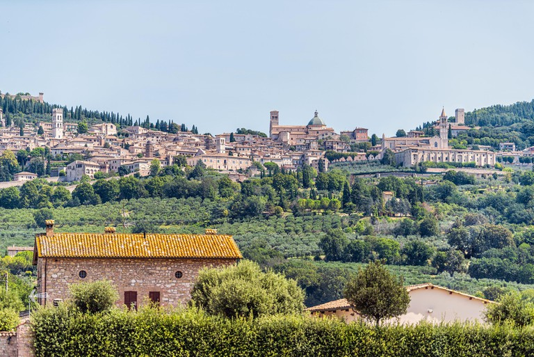 Village town city of Assisi in Umbria, Italy cityscape of famous church during summer day landscape in Etruscan countryside