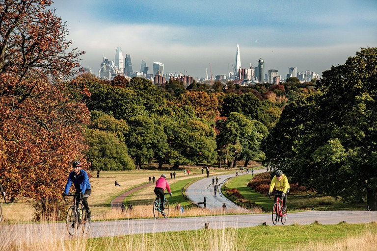 Cycling in Richmond Park with a backdrop of the City of London