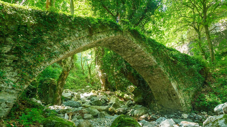 The beautiful stone bridge of Tsagkarada (constructed in 1787), in Mount Pelion, a marvelous piece of local architecture, almost consumed by nature.
