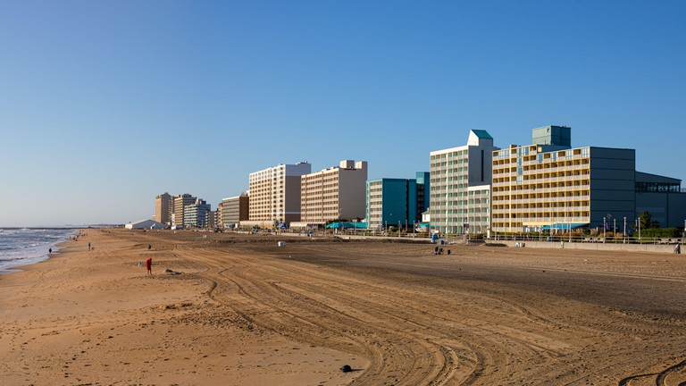 Virginia Beach, city in the state of Virginia, at the Atlantic coast, United States of America, during clear sky, and surfers enjoying the waves