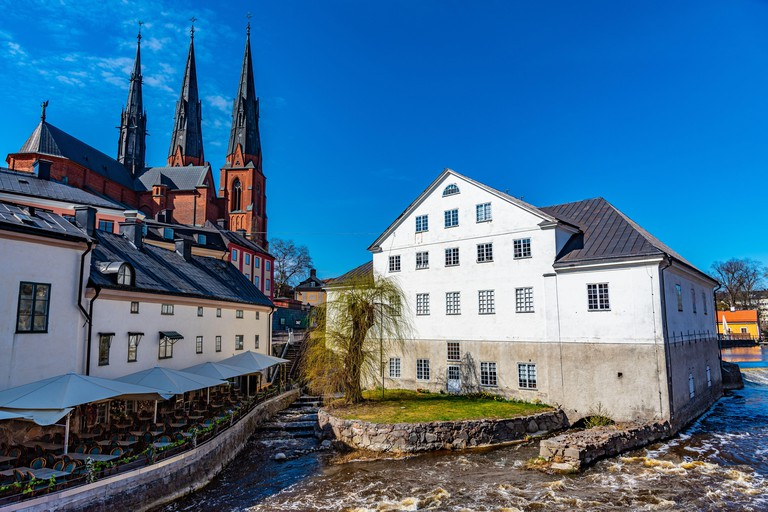 White building of Uppland museum and cathedral in Uppsala, Sweden