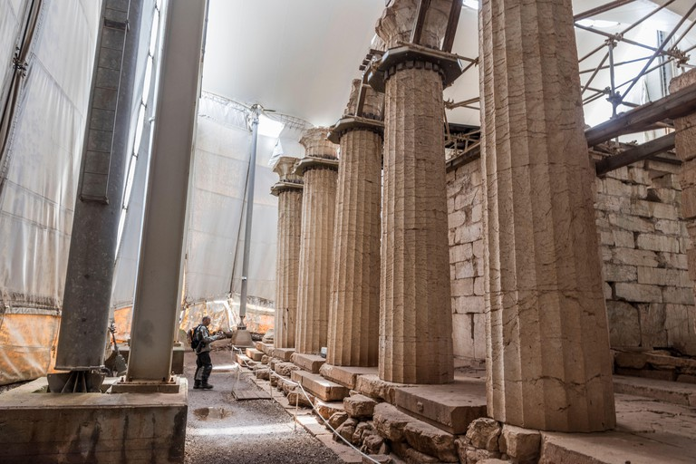 Bassae, Greece. Large ruined columns of the Temple of Apollo Epicurius inside a tent