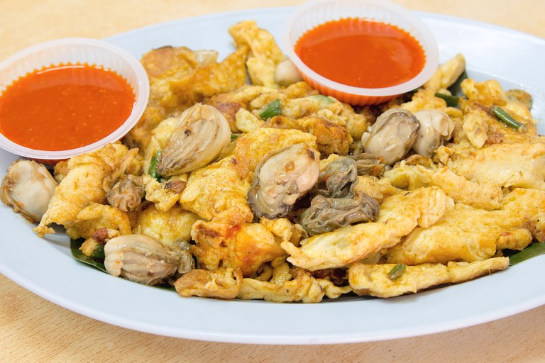 Southeasat Asian Fried Baby Oyster Omelette Oh Chien with Chili Sauce Closeup