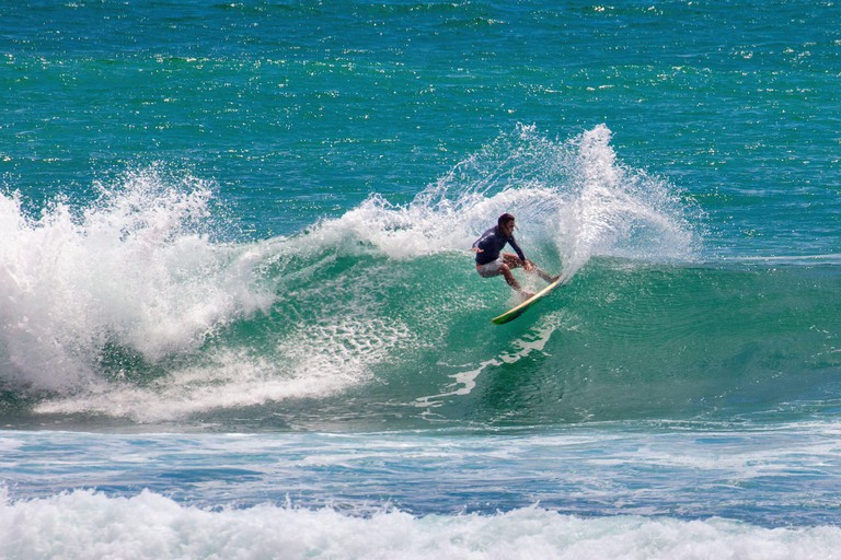 Sri Lanka, Ahangama, Surf beach. Surfer.