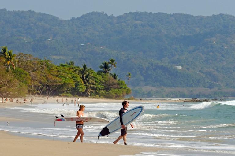 Surfer at the beach of Santa Teresa, Mal Pais, Nicoya Peninsula, Costa Rica, Central America