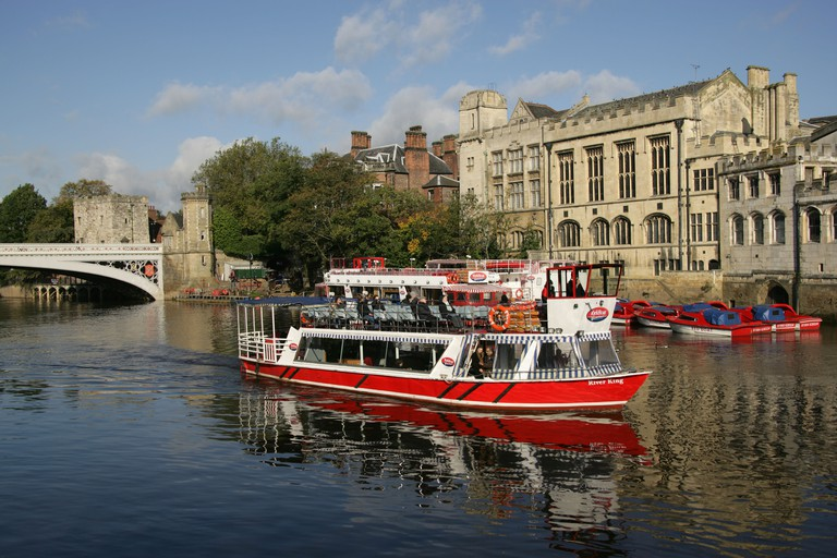 City of York, England. Yorkboat cruise boat transiting the River Ouse with the Guildhall and Lendal Bridge in the Background.. Image shot 2008. Exact date unknown.