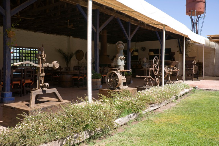 Old winemaking machinery at the Viu Manent Vineyard, Colchagua Valley, Chile