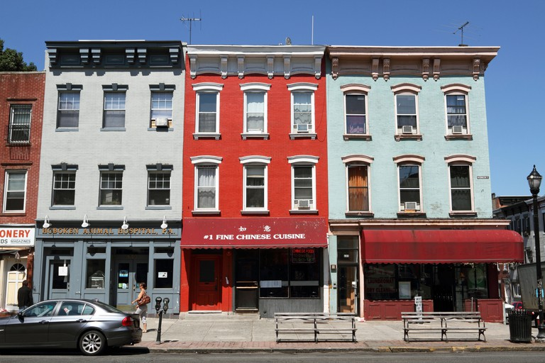Row Houses and apartment buildings line Washington Street, the main thoroughfare in Hoboken, New Jersey, USA. C5CBH0
