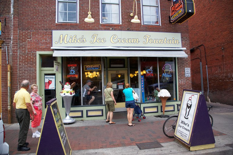 tourists enter mikes ice cream fountain shop on broadway Nashville Tennessee USA