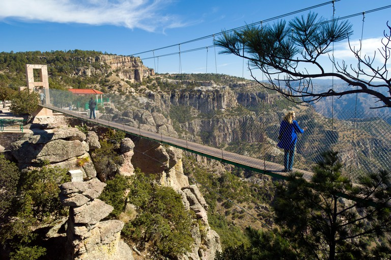 Suspension bridge and viewpoint overlooking Copper Canyon at Divisadero, Chihuahua, Mexico.