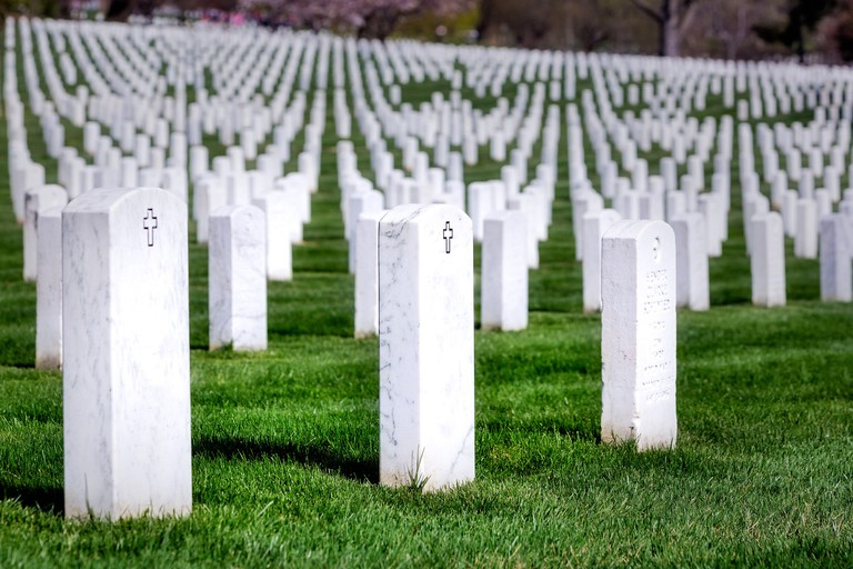 Symmetrical rows of tombs from our brave men and woman of the United States Military, resting at Arlington National Cemetery,in Virginia.