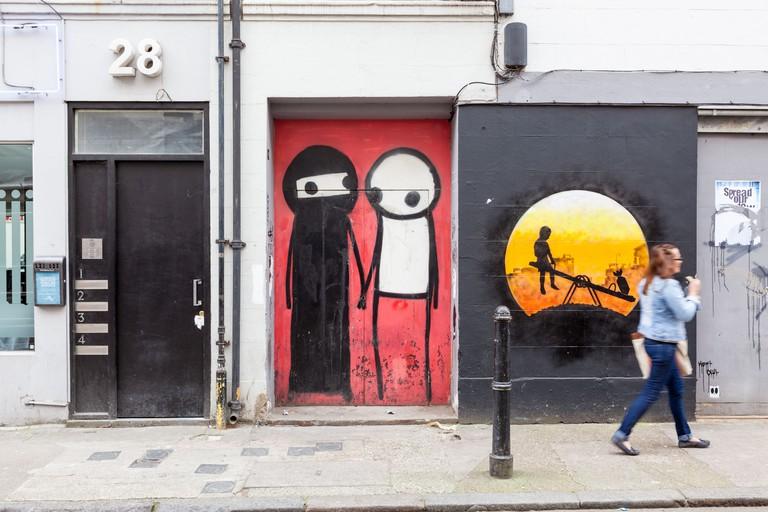 DYPWRG Stix holding hands on Princelet Street, London