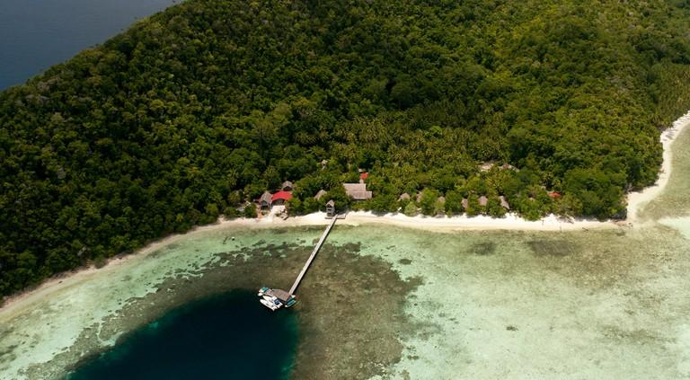 Aerial of Kri Island, Kri Eco Resort and Sorido Bay Resort. Raja Ampat, West Papua, Indonesia, February 2010