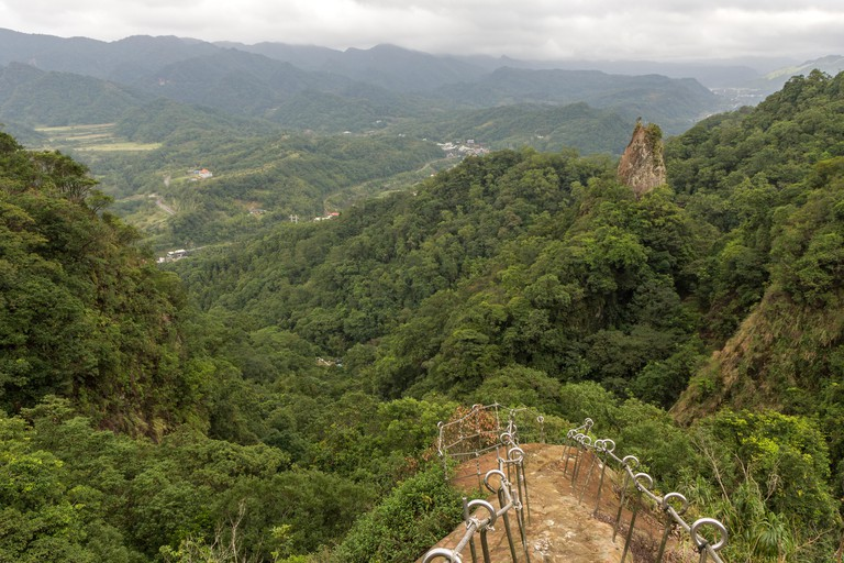 Scenic landscape of green and lush hills, valley and crags at Pingxi in Taiwan at a cloudy day