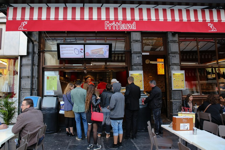 fritland fast food joint in Brussels specializes in French fries/potato chips. Image shot 2014. Exact date unknown.