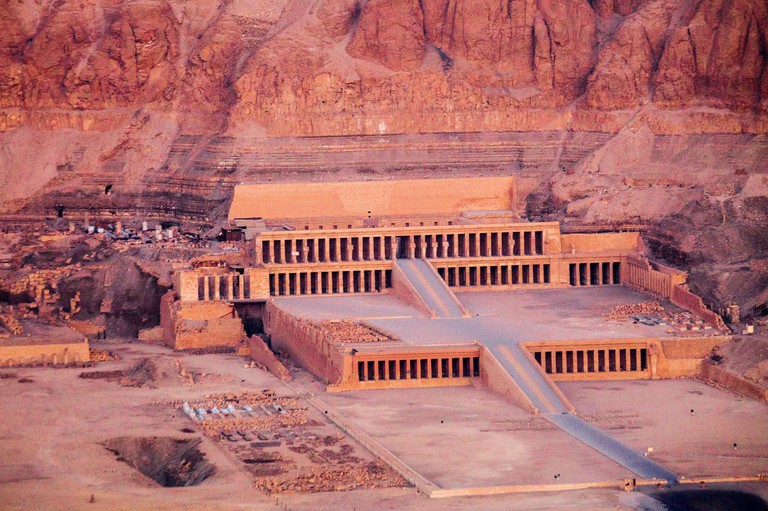 Aerial view of the Temple of Queen Hatshepsut in Deir el-Bahari on the West Bank of the Nile at sunrise.