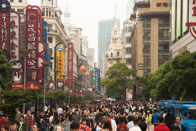 crowds of walkers throng Nanjing Road pedestrian street in downtown Shanghai China