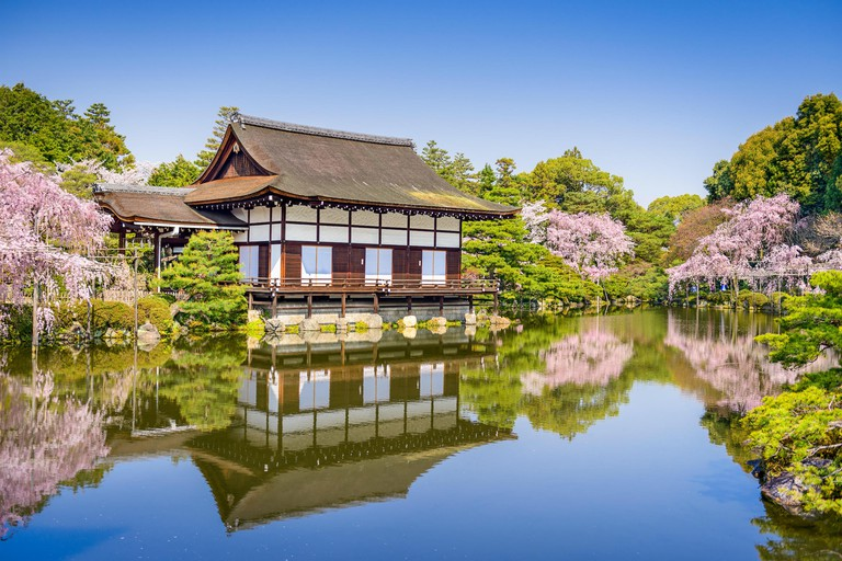 Kyoto, Japan spring at Heian Shrine's pond garden and special events hall.