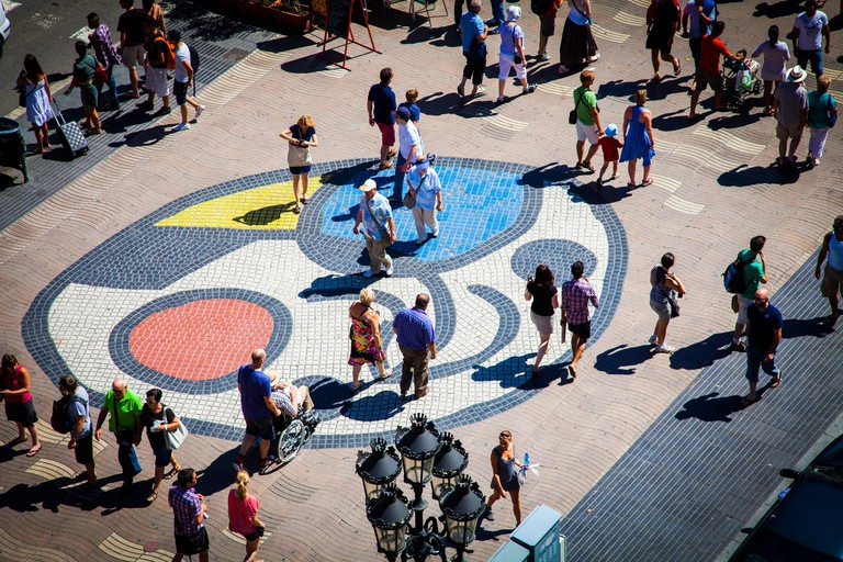 La Rambla, Pla de la Boqueria  with mosaic by Joan Miro, Barcelona, Catalonia, Spain.