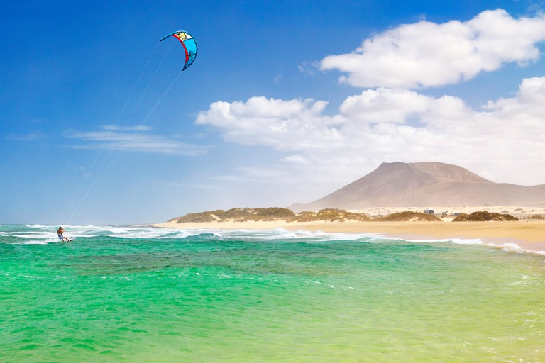 Kitesurfing at the beach near Corralejo, Fuerteventura Island, Canary Islands, Spain,