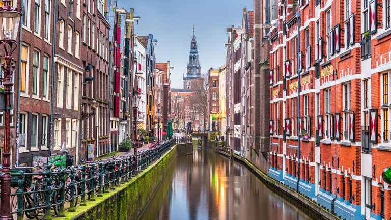 Amsterdam, Netherlands canals and church tower at dawn-2B8JJF3