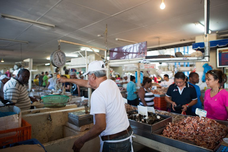 PANAMA CITY, Panama--The buzzing Mercado de Mariscos (Seafood Market) on the waterfront next to Casco Viejo in Panama City. In one section, vendors sell fresh seafood of all types, while next to it are a series of outdoor seafood restaurants where ceviche