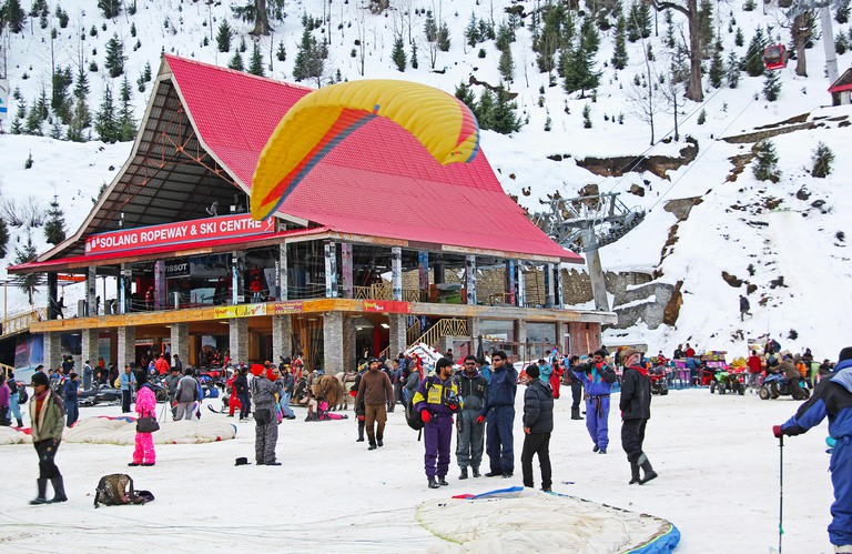 Tourists engaged in paragliding, skiing and  other sports at Winter Sports Centre at Solang Valley of Himalaya in Manali, India.