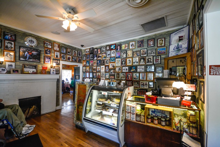Reception, register area with famous Country Stars photo head shots on wall of Fame at the Loveless Cafe & Motel, Nashville, TN