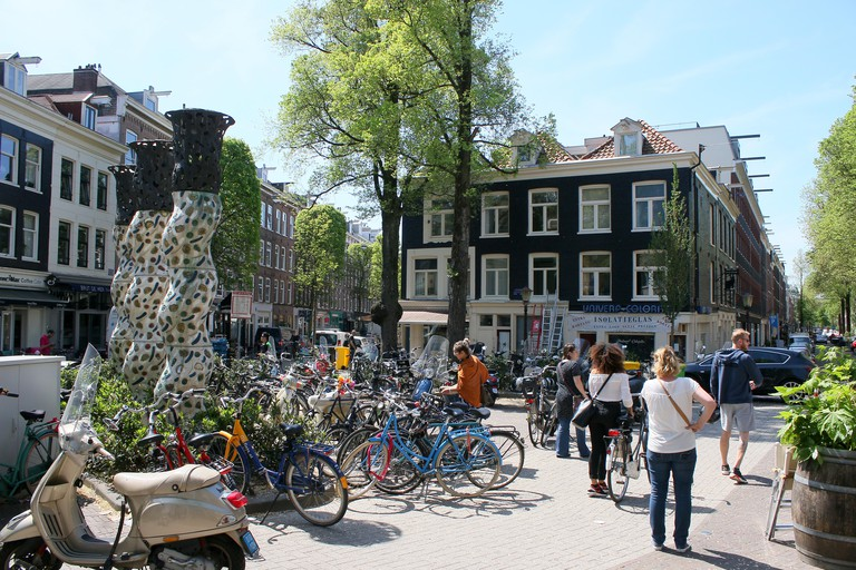 Cafes and people on terraces at Gerard Douplein square, De Pijp area, Amsterdam Oud Zuid, Netherlands. Spring 2016