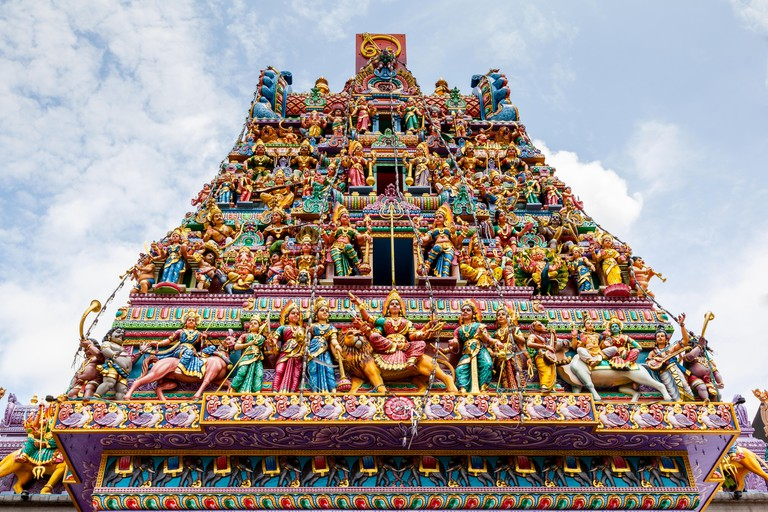 Intricate Hindu art and deity carvings on the facade of Sri Veeramakaliamman Temple in Little India, Singapore.